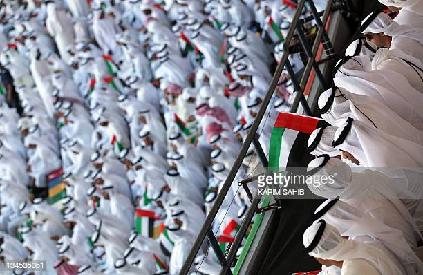 Emiratis wave national flags as citizens celerbate their countr'es 40 years of independence on National Day in Abu Dhabi on December 2 2011 AFP...