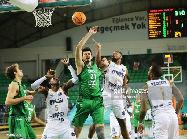 Emircan Kosut of Darussafaka Tekfen in action against James Bell of Happy Casa Brindisi during FIBA Champions League Group H basketball match between...