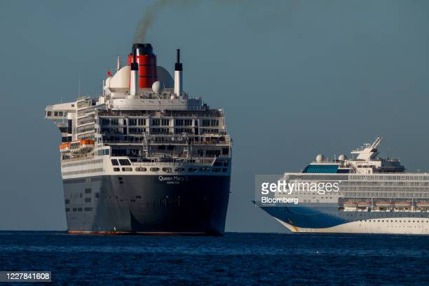 Emissions blow from the Queen Mary 2 cruise ship, operated by Carnival Plc, as it navigates near the Marella Explorer cruise ship, operated Tui AG,...