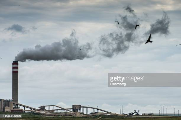 Emissions rise from a tower of the Eskom Holdings SOC Ltd. Kusile coal-fired power station in Mpumalanga, South Africa, on Monday, Dec. 23, 2019. The...