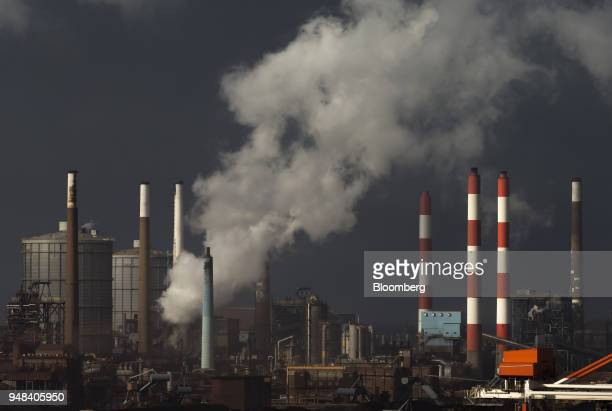 Emissions rise from chimneys at the Nippon Steel Sumitomo Metal Corp plant stands in Kashima Ibaraki Japan on Wednesday April 18 2018...