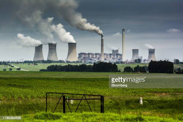 Emissions rise from the cooling towers of the Eskom Holdings SOC Ltd. Matla coal-fired power station in Mpumalanga, South Africa, on Monday, Dec. 23,...