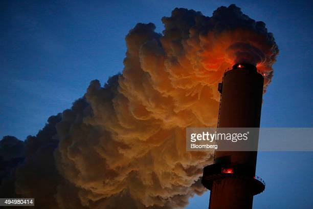 Emissions rise from the Northern Indiana Public Service Co Bailly generating station on the shore of Lake Michigan at dusk in Chesterton Indiana US...