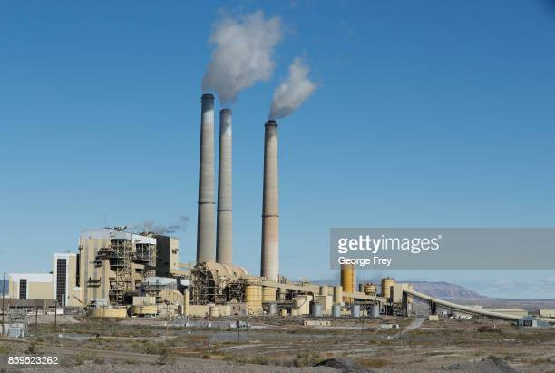 Emissions rise from the smokestacks of Pacificorp's 1440 megawatt coal fired power plant on October 9 2017 in Castle Dale Utah It was announced today...