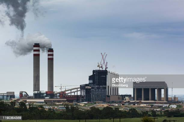 Emissions rise from towers of the Eskom Holdings SOC Ltd. Kusile coal-fired power station in Mpumalanga, South Africa, on Monday, Dec. 23, 2019. The...