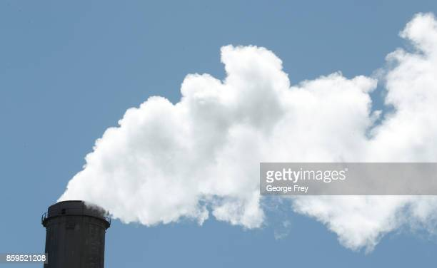Emissions rise out of a large smoke stack at Pacificorp's 1000 megawatt coal fired power plant on October 9 2017 outside Huntington Utah It was...