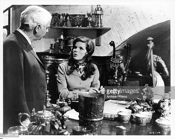 Emlyn Williams finds Samantha Eggar after looking for her in a scene from the film 'The Walking Stick' 1970