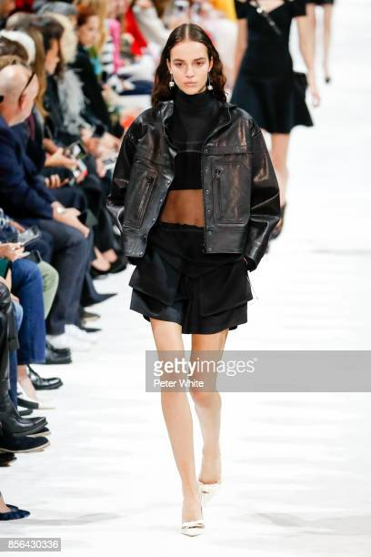 Emm Arruda walks the runway during the Valentino show as part of the Paris Fashion Week Womenswear Spring/Summer 2018 on October 1 2017 in Paris...