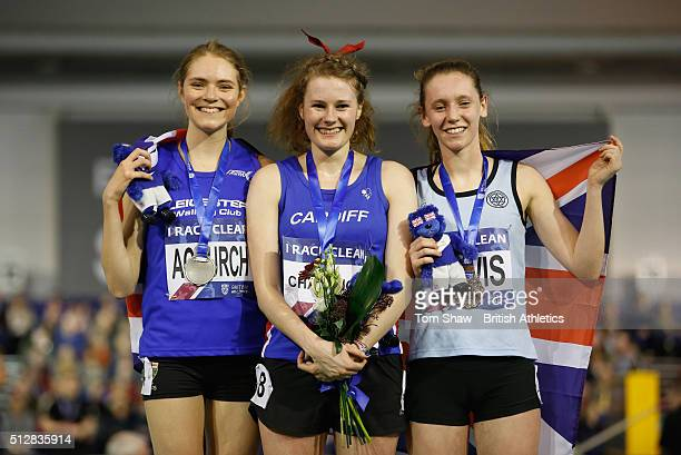 Emma Achurch of Leicester Bethan Davies of Cardiff and Sophie Lewis Ward of Cambridge pose with their medals during day 2 of the Indoor British...