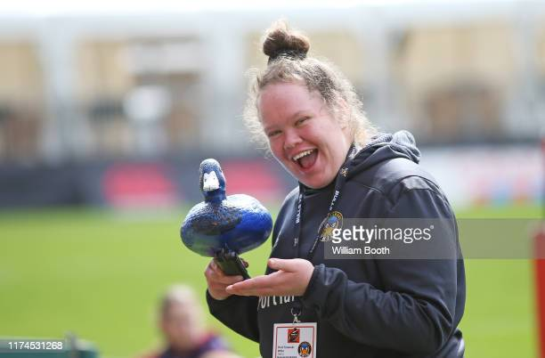 Emma Andrews of Taranaki poses for a photo with the team mascot whio duck prior the round 3 Farah Palmer Cup match between Taranaki and Tasman at...