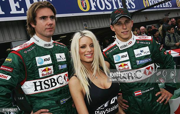 Emma B, Bjorn Wirdheim and Christian Klien pose in front of the Jaguar R5 to promote the PlayStation 2 game Formula One 04 prior to the Formula One...