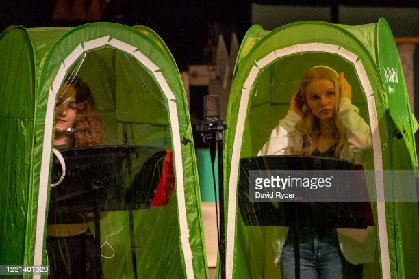 Emma Banker and Jessi McIrvin record vocals in pop-up tents during choir class at Wenatchee High School on February 26, 2021 in Wenatchee,...
