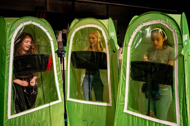 WA: School Band And Choir Members Practice In Tents As Students Return To Classrooms