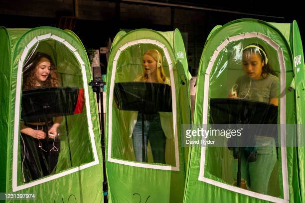 Emma Banker, Jessi McIrvin, and Valerie Sanchez record vocals in pop-up tents during choir class at Wenatchee High School on February 26, 2021 in...