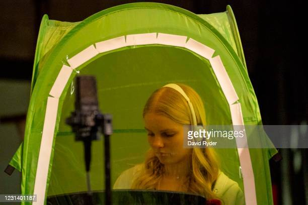 Emma Banker records vocals in a pop-up tent during choir class at Wenatchee High School on February 26, 2021 in Wenatchee, Washington. The school has...