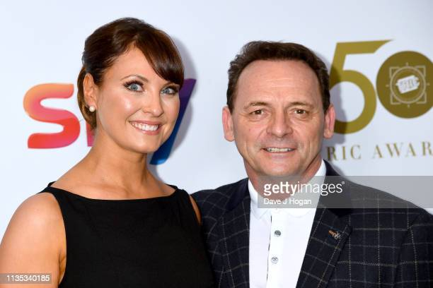 Emma Barton and Perry Fenwick attend the 2019 'TRIC Awards' held at The Grosvenor House Hotel on March 12 2019 in London England