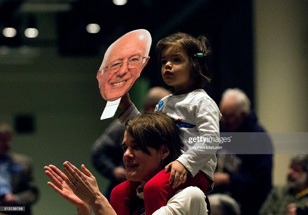 Emma Belalcazar holds a sign as she sits on her mother, Alison Campbell's, shoulders at a campaign rally for Democratic presidential candidate Sen. Bernie Sanders (D-VT) at the Minneapolis Convention Center February 29, 2016 in Minneapolis, Minnesota. Sanders, who has spent the last four days campaigning in Minnesota, is hoping to win the State in the Super Tuesday primary election on March 1st, 2016.