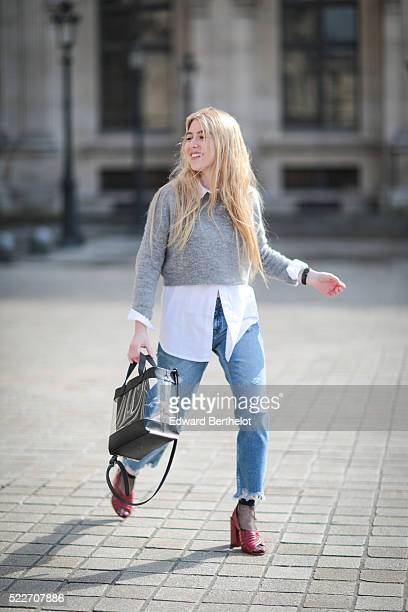 Emma Bonneaud is wearing Zara red shoes Mango blue jeans a Wanted Gina white shirt an Asos gray pullover a Daniel Wellington watch a Zara bag and a...