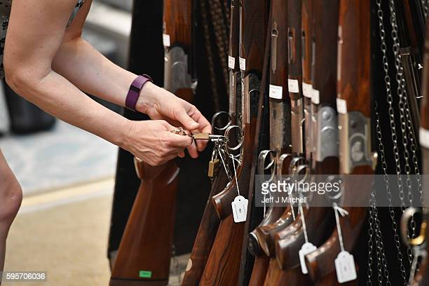 Emma Budd prepares sporting guns and rifles at Gleneagles Hotel on August 26 2016 in Aucterarder Scotland The annual auction of Fine Modern and...