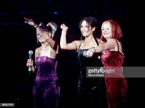 Emma Bunton Victoria Adams and Geri Halliwell of The Spice Girls perform on stage at the Olympiahalle on March 26th 1998 in Munich Germany