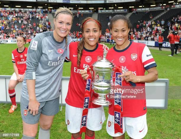 Emma Byrne Alex Scott and Rachel Yankey celebate Arsenal's FA Cup win after the match at Stadium mk on June 1 2014 in Milton Keynes England