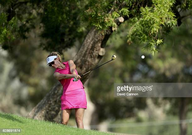 Emma Cabrera-Bello of Spain plays her second shot on the 10th hole during the delayed second round of the 2016 Omega Dubai Ladies Masters on the...