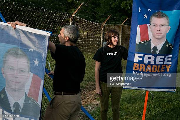 Emma Cape right and Patrick ConwayÊset up signs as protesters with the Bradley Manning Support Network hold a vigil while waiting to hear Manning's...