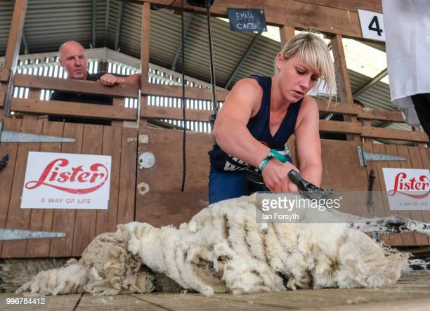 Emma Carter shears sheep during a competition at the 160th Great Yorkshire Show on July 10 2018 in Harrogate England First held in 1838 the show...