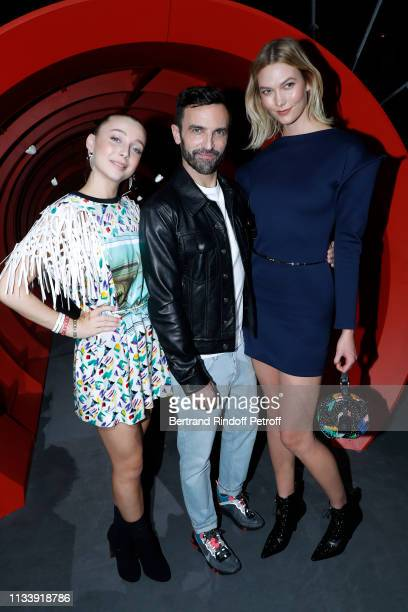 Emma Chamberlain Stylist Nicolas Ghesquiere and Karlie Kloss pose after the Louis Vuitton show as part of the Paris Fashion Week Womenswear...