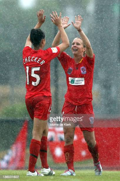 Emma Checker and Ashleigh Gunning of Adelaide celebrate after the round nine W-League match between Adelaide United and Perth Glory at Burton Park on...