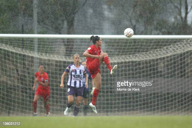 Emma Checker of Adelaide kicks the ball in the air during the round nine W-League match between Adelaide United and Perth Glory at Burton Park on...