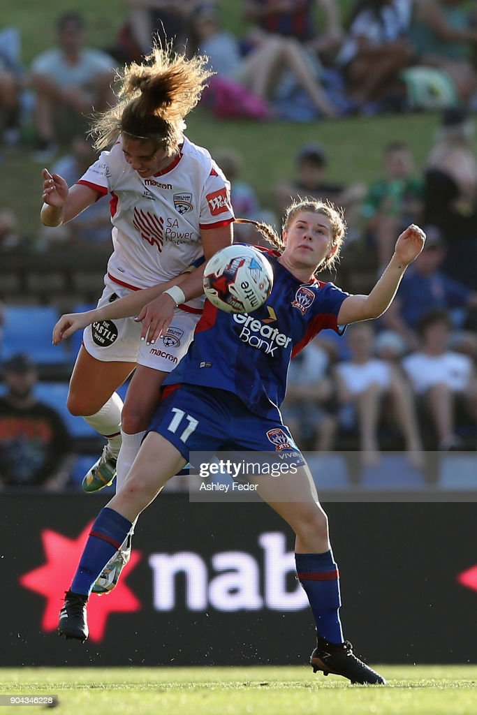 Emma Checker of Adelaide United contests the ball against Cortnee Vine of the Jets during the round 11 W-League match between the Newcastle Jets and Adelaide United at McDonald Jones Stadium on January 12, 2018 in Newcastle, Australia.