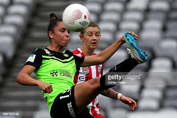Emma Checker of Canberra contests the ball against Larissa Crummer of Melbourne City during the round four WLeague match between Canberra United and...