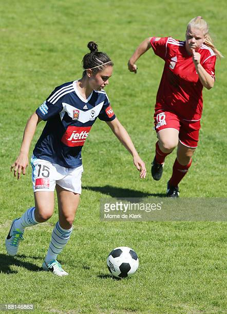 Emma Checker of Victory wins the ball over her former teammate Jessica Waterhouse of Adelaide during the round two WLeague match between Adelaide and...