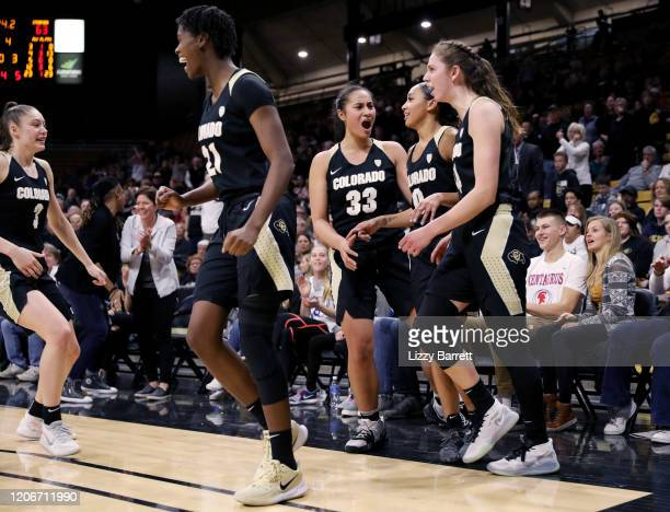 Emma Clarke Mya Hollingshed Peanut Tuitele and Aubrey Knight celebrate with Quinessa CaylaoDo of the Colorado Buffaloes after her rebound during the...