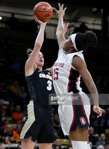 Emma Clarke of the Colorado Buffaloes attempts to shoot over the defense of Maya Dodson of the Stanford Cardinal during the fourth quarter of a game...