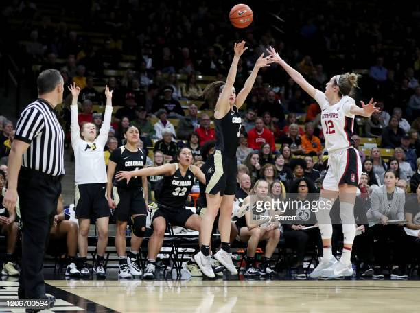 Emma Clarke of the Colorado Buffaloes shoots over the defense of Lexie Hull of the Stanford Cardinal during the third quarter of a game between the...