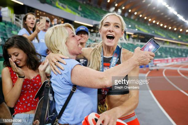 Emma Coburn celebrates with her mother Annie Coburn after competing in the Women's 3,000 Meter Steeplechase Final on day seven of the 2020 U.S....