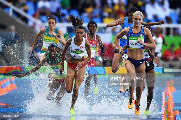 Emma Coburn of the United States and Habiba Ghribi of Tunisia compete in the Women's 3000m Steeplechase Round 1 on Day 8 of the Rio 2016 Olympic...
