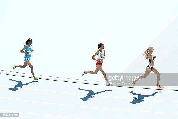 Emma Coburn of the United States, Habiba Ghribi of Tunisia and Lalita Shivaji Babar of India competes in the Women's 3000m Steeplechase Round 1 on...