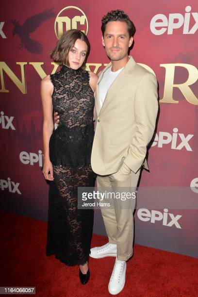 Emma Corin and Ben Aldridge arrive at the LA Premiere of Epix's 'Pennyworth' at Harmony Gold on July 24 2019 in Los Angeles California