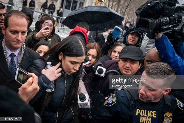 Emma Coronel Aispuro wife of Joaquin El Chapo Guzman is surrounded by security and members of the press as she exits the US District Court for the...