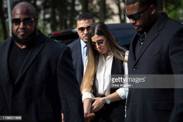 Emma Coronel Aispuro wife of Joaquin El Chapo Guzman is surrounded by security as she arrives at federal court on July 17 2019 in New York City El...