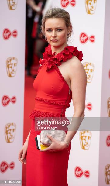 Emma Corrin seen on the red carpet during the Virgin Media British Academy Television Awards at The Royal Festival Hall in London