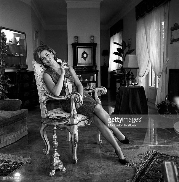 Emma Danieli poses languidly seated on an armchair during an interview in the sitting room of her house the Italian actress smoking a cigarette and...