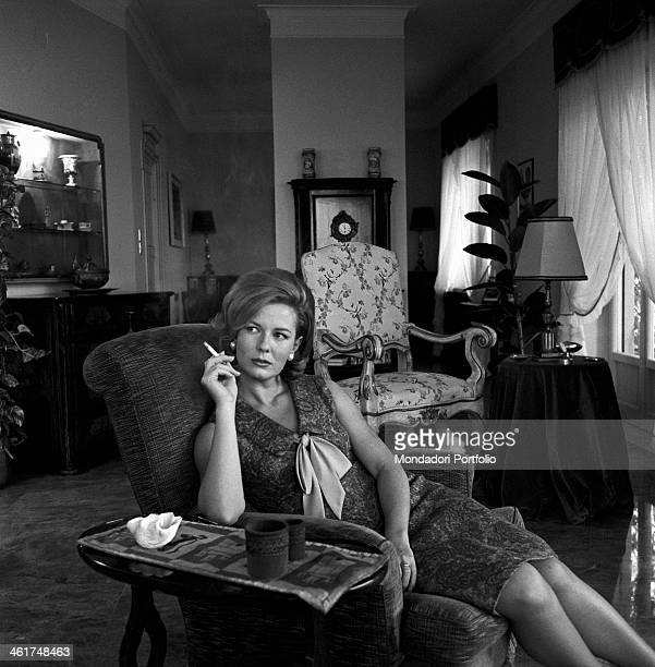 Emma Danieli sits comfortably on the upholstered armchair in the middle of her elegant sitting room smoking a cigarette the Italian actress recently...