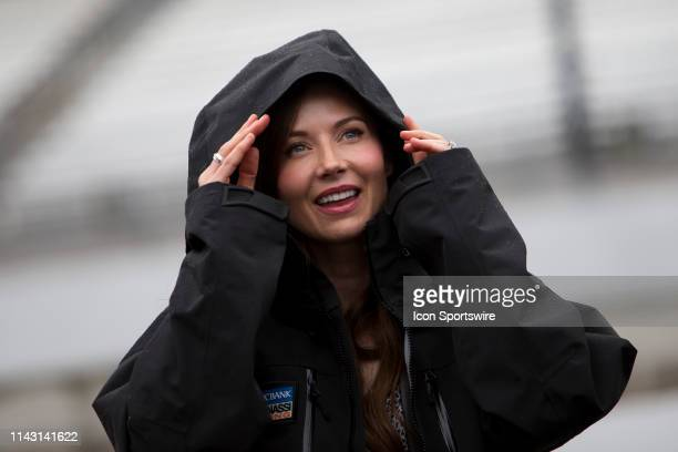 Emma Davies-Dixon, the wife of Chip Ganassi Racing driver Scott Dixon of New Zealand watches the monitor with anticipation during the IndyCar Grand...