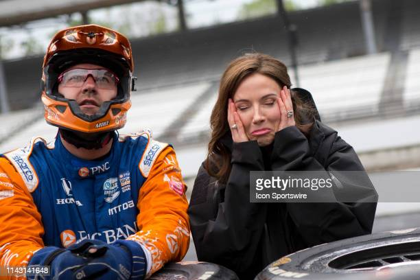 Emma Davies-Dixon, the wife of Chip Ganassi Racing driver Scott Dixon of New Zealand reacts to her husband being passed during the IndyCar Grand Prix...