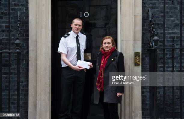 Emma Dent Coad British Labour Party Member of Parliament hands in a petition at 10 Downing Street from anti war demonstrators during a protest...