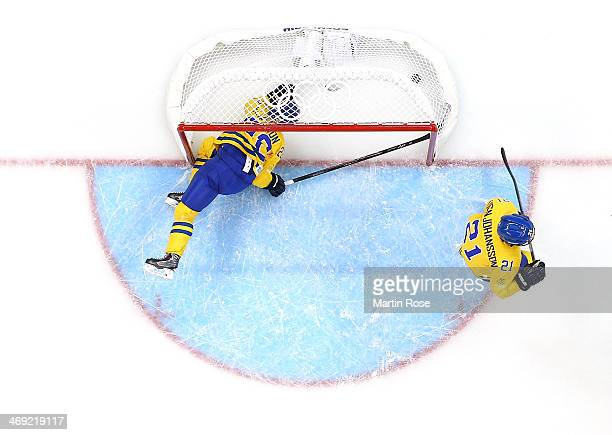Emma Eliasson of Sweden dives into the net trying to stop a puck against Russia in the third period during the Women's Ice Hockey Preliminary Round...